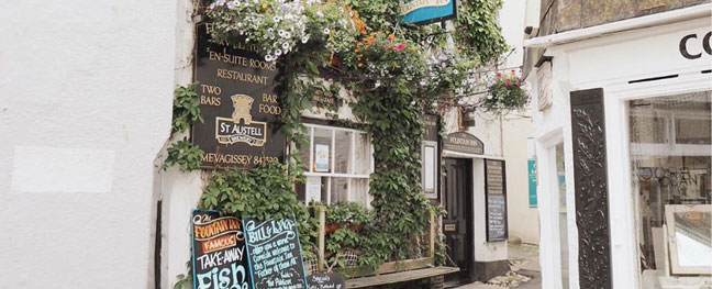 The outside of a pub in Mevagissey in Cornwall